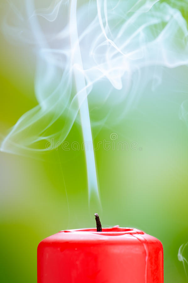 Extinguished Red Candle With Smoke Royalty Free Stock Photos