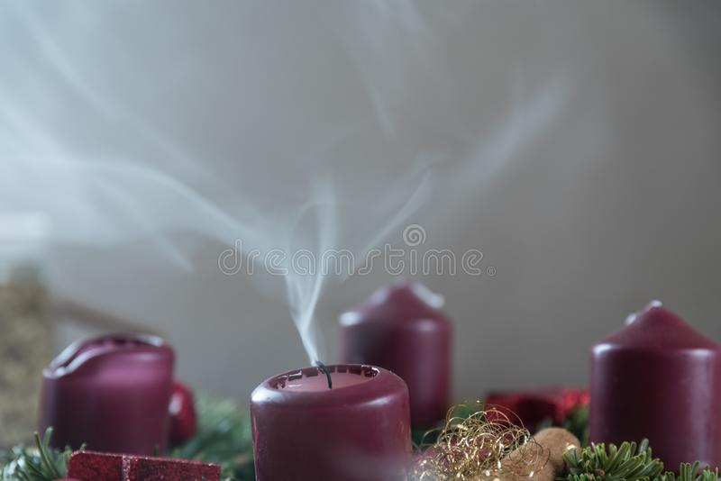 Extinguishing advent candle - closeup stock image