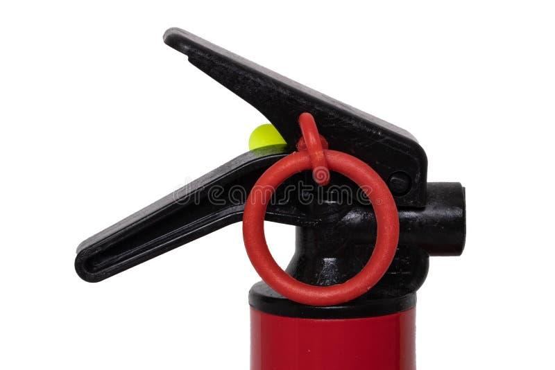Extintor de incêndio Detalhe do close-up de um extintor vermelho pequeno com a montagem da parede isolada em um fundo branco Casa fotografia de stock royalty free