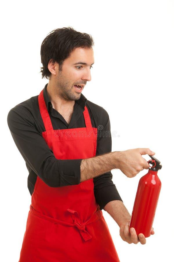 Extintor del cocinero foto de archivo