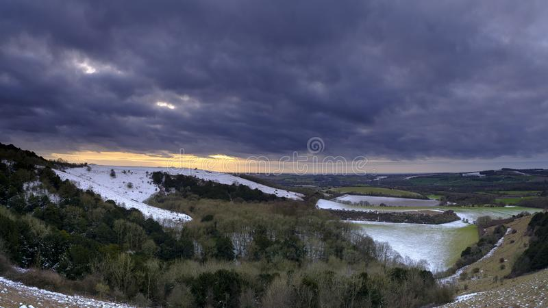 Snowy sunset view across the Meon Valley towards Old Winchester Hill, South Downs National Park, Hampshire, UK stock image