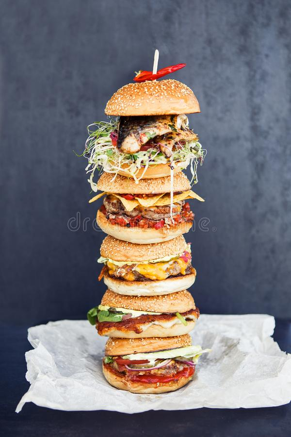 Extra big burger on the black background stock images