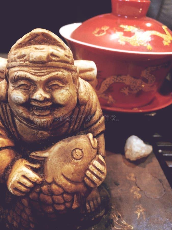 Extra close-up, het standbeeld van de theegod, de theeceremonie, royalty-vrije stock afbeeldingen
