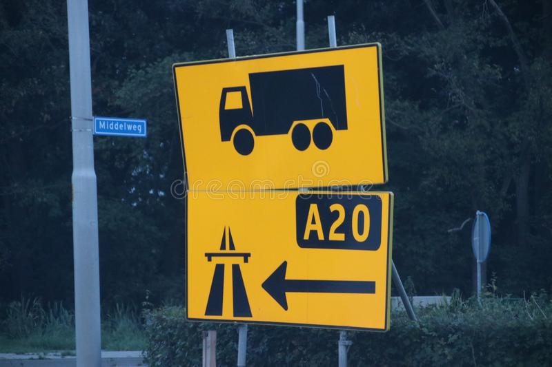 Extra direction signs in yellow for trucks for new road because drivers don`t update their navigation and was creating traffic is stock photography