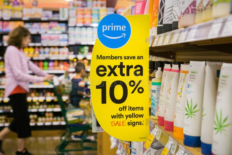 Extra discount sign at a Whole Foods store. August 30, 2018 Los Altos / CA / USA - Sign advertising that Amazon offers additional discounts for Prime members at royalty free stock photo