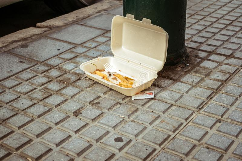 Extra food waste and scraps with and a rest of the cigarette in plastic box thrown stock photography