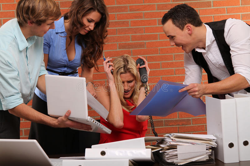 Extra hours. Multitasking business scene with some colleagues and typical business stuff and symbols stock photography
