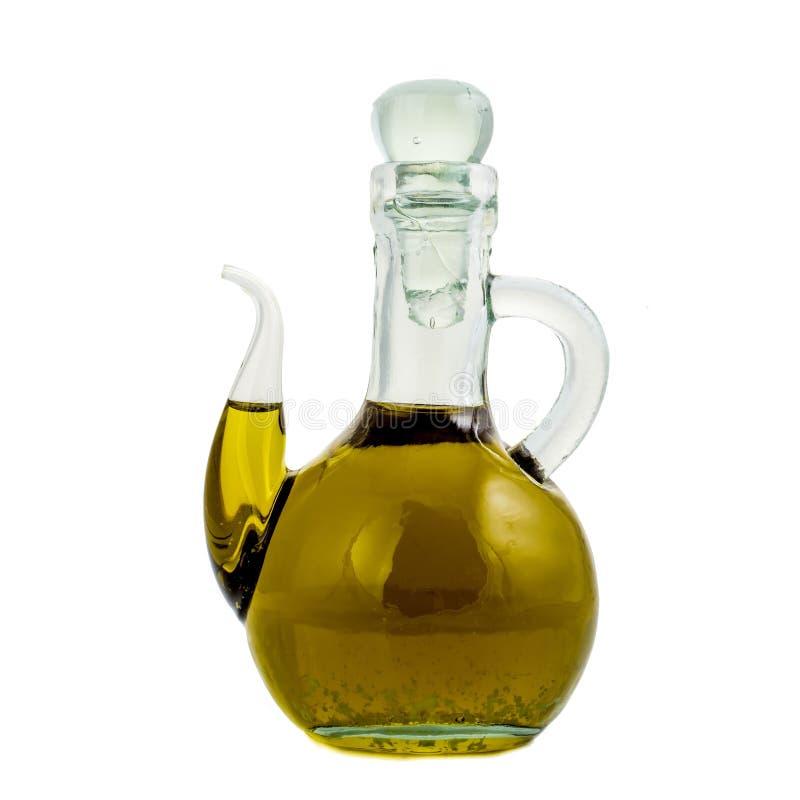 Extra jungfrulig isolerad olivoljaexponeringsglaskrus royaltyfri fotografi