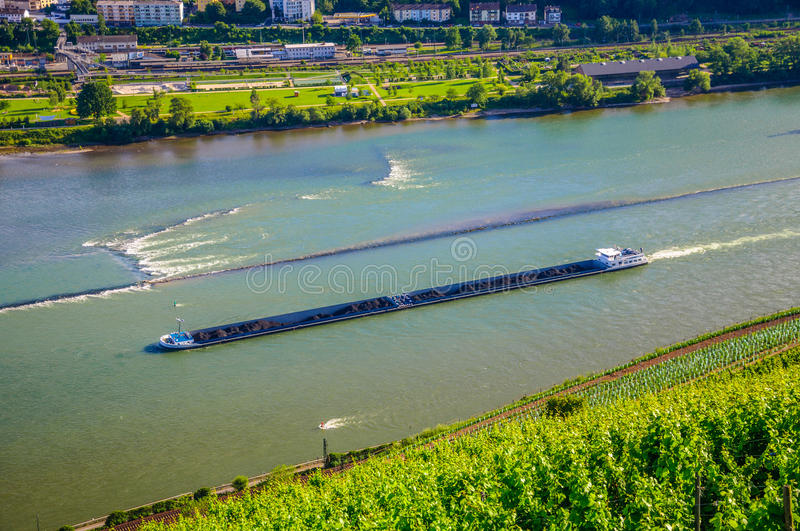 Extra long barge ship is transporting coal on Rhine river near B royalty free stock photos