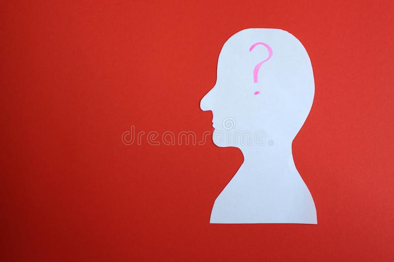 Image of a man man cut out of paper cartoon with question mark stock photo