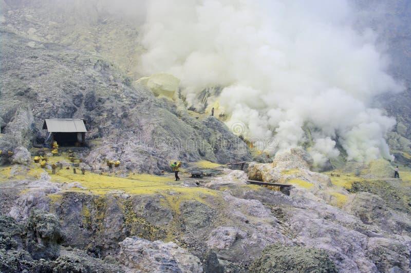 extracting sulphur inside Kawah Ijen crater royalty free stock image