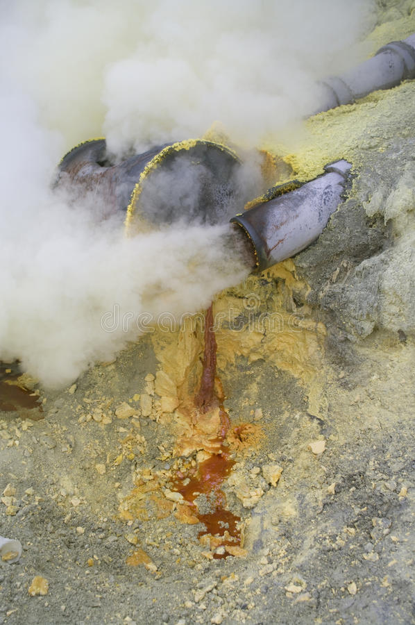 Extracting sulphur inside Kawah Ijen crater royalty free stock photo