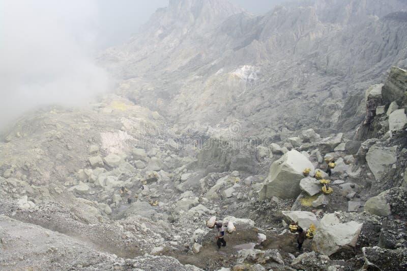 Extracting sulphur inside Kawah Ijen crater stock image