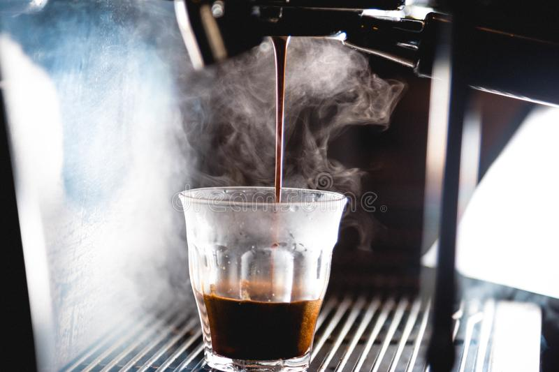 Extraction of an espresso with bright light royalty free stock image