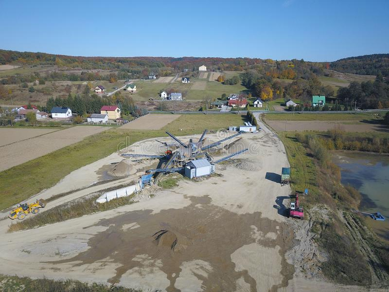 Extraction, washing, sorting and distraction of river gravel. Mining industry. Technology of obtaining a stone. A bird`s eye view. Shooting with a quadrocopter stock photo