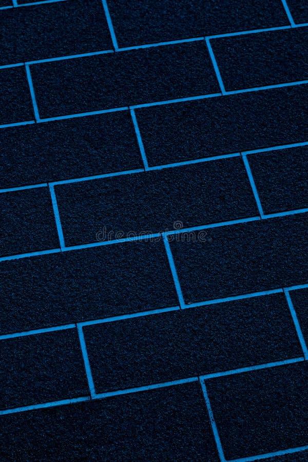 Extracto azul del primer de la pared de ladrillos foto de archivo