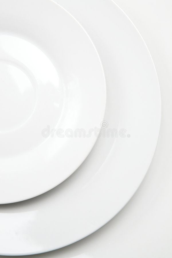 Extracto blanco de los platos foto de archivo