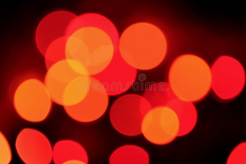 Extracto Bokeh de la luz de adornamiento iluminada anaranjada y roja fotografía de archivo libre de regalías