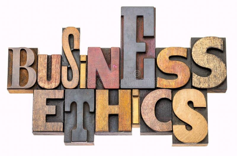 Extracto de la palabra de la ética empresarial en el tipo de madera foto de archivo libre de regalías