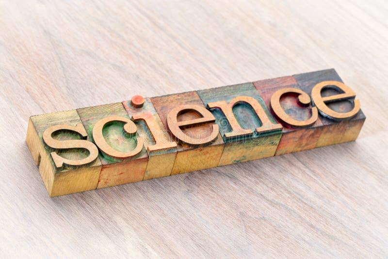 Extracto de la palabra de la ciencia en el tipo de madera fotografía de archivo
