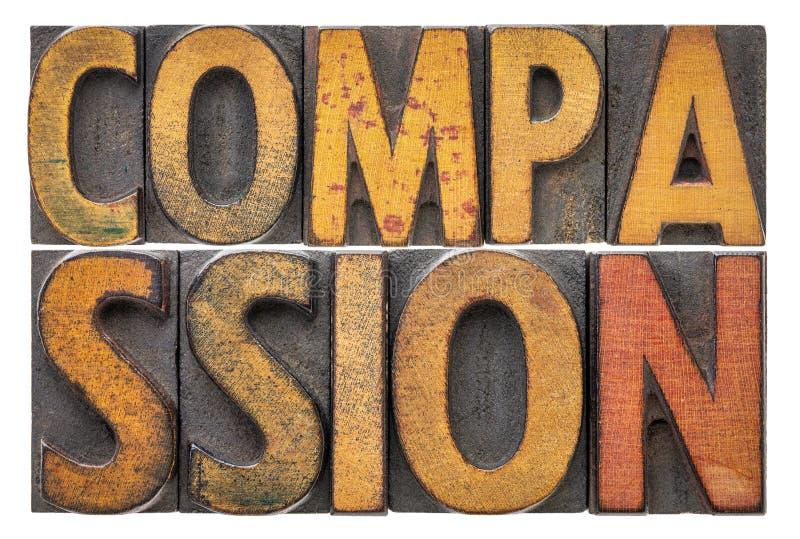 Extracto de la palabra de la compasión en el tipo de madera fotografía de archivo libre de regalías