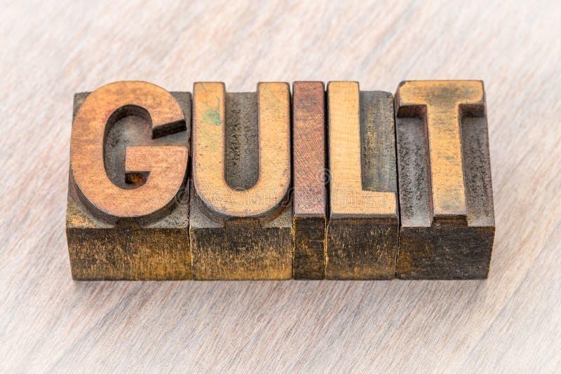 Extracto de la palabra de la culpabilidad en el tipo de madera foto de archivo libre de regalías