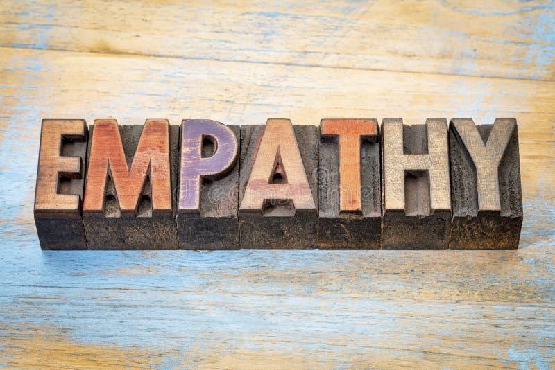 Extracto de la palabra de la empatía en el tipo de madera imágenes de archivo libres de regalías