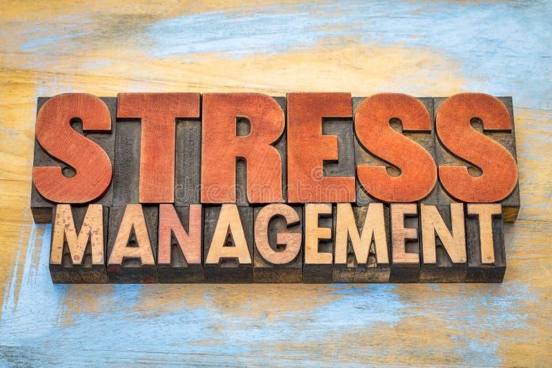 Extracto de la palabra de la gestión del estrés en el tipo de madera foto de archivo