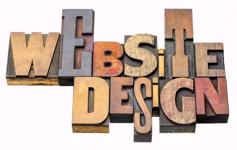 Extracto de la palabra del diseño del sitio web en el tipo de madera imagenes de archivo