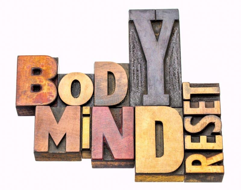 Extracto de la palabra del reset del cuerpo y de la mente fotografía de archivo libre de regalías