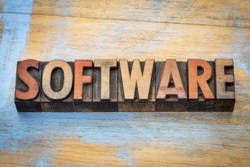 Extracto de la palabra del software en el tipo de madera imágenes de archivo libres de regalías