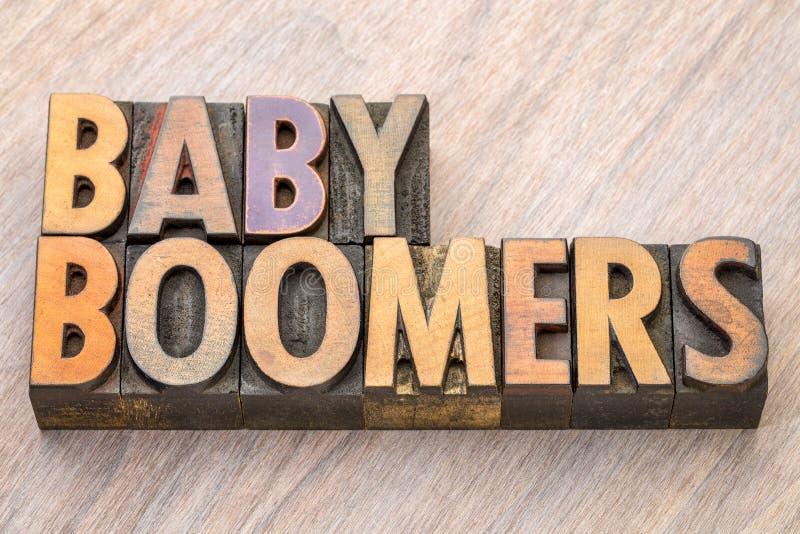 Extracto de la palabra de los nacidos en el baby boom en el tipo de madera fotos de archivo