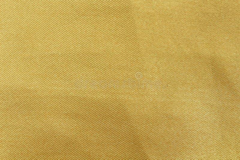 Extracto de la textura de la tela del oro para el fondo fotos de archivo libres de regalías