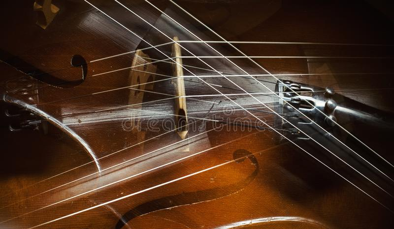 Extracto de los detalles del violoncelo fotografía de archivo
