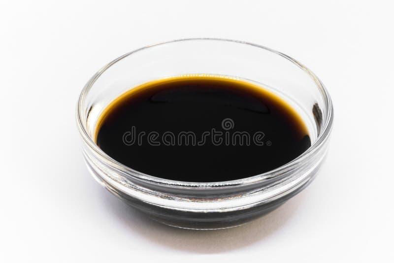 Extracto de vainilla en un cuenco del ingrediente fotos de archivo