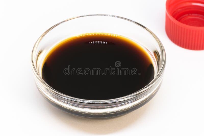 Extracto de vainilla en un cuenco del ingrediente imagen de archivo libre de regalías