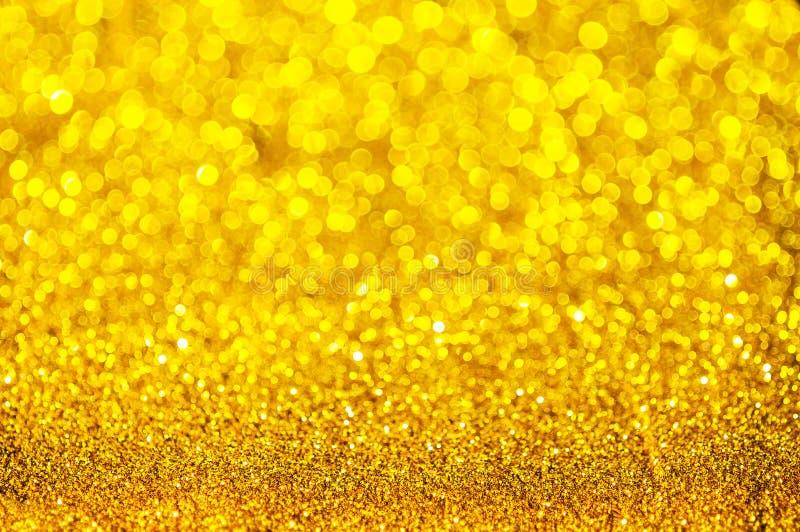 Extracto del color del oro de Bokeh foto de archivo libre de regalías