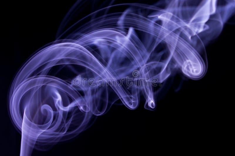 Extracto púrpura del humo imagen de archivo