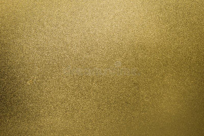 Extracto p de la hoja de la pendiente de la chispa de la textura del brillo del fondo del oro fotografía de archivo libre de regalías