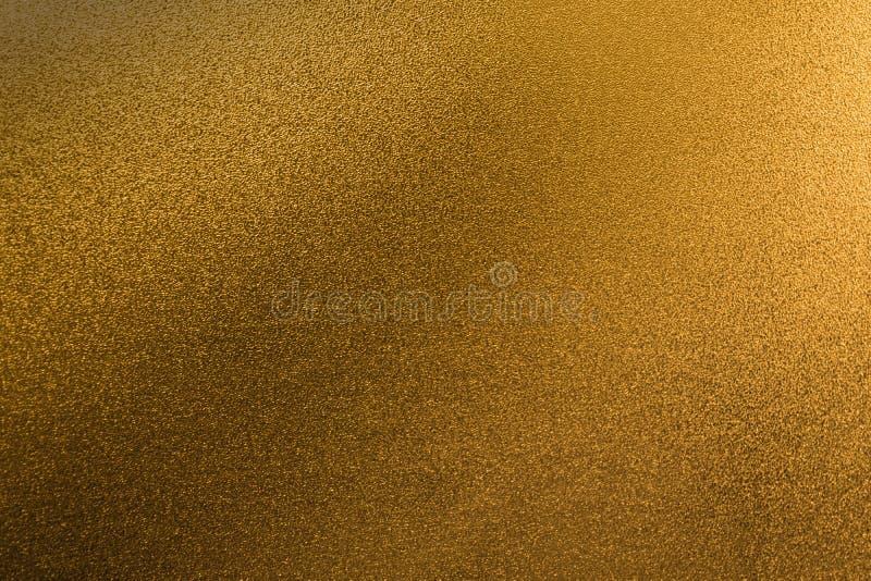 Extracto p de la hoja de la pendiente de la chispa de la textura del brillo del fondo del oro imagen de archivo