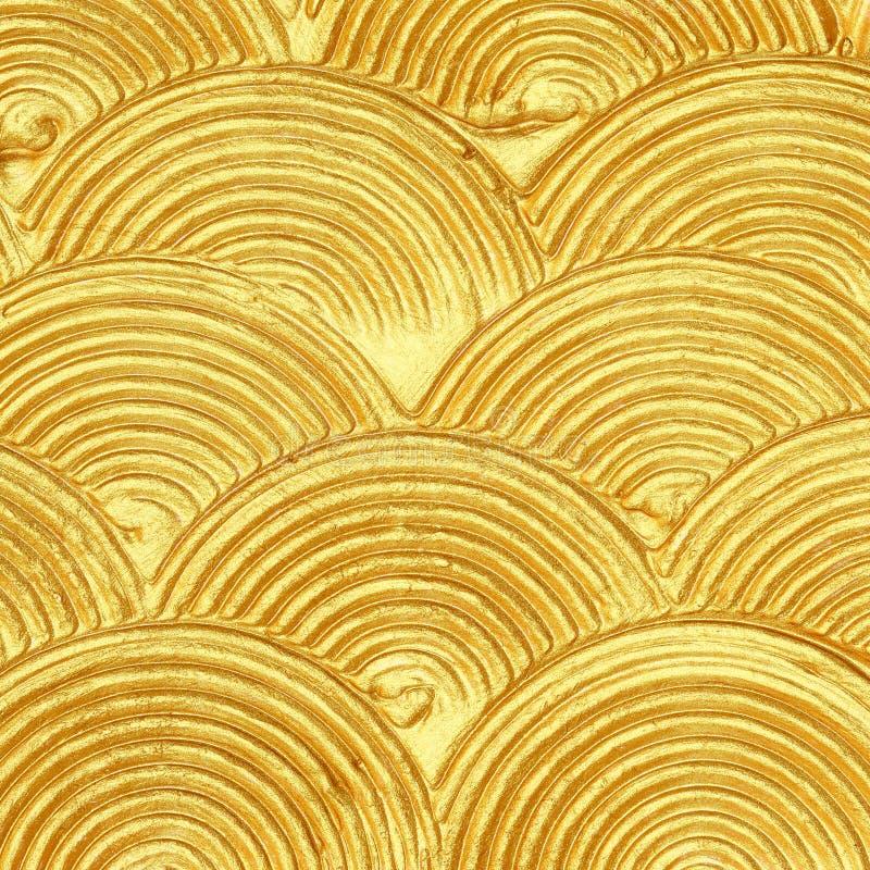 Extracto texturizado acrílico de la pintura del oro imagenes de archivo