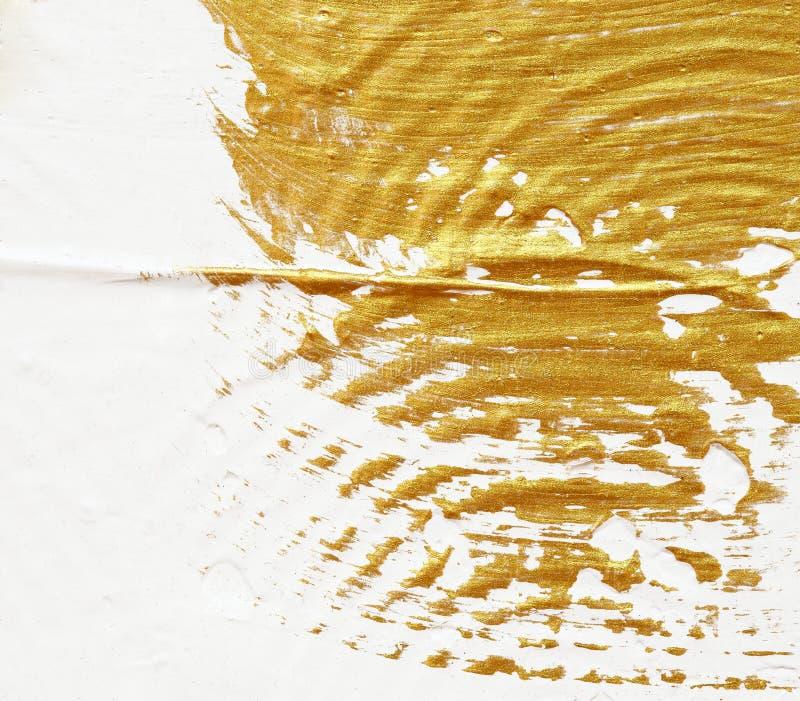 Extracto texturizado acrílico de la pintura del oro foto de archivo