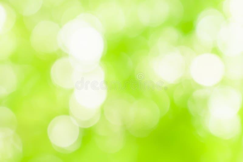 Extracto verde y amarillo del fondo, el fondo ligero del bokeh imagenes de archivo