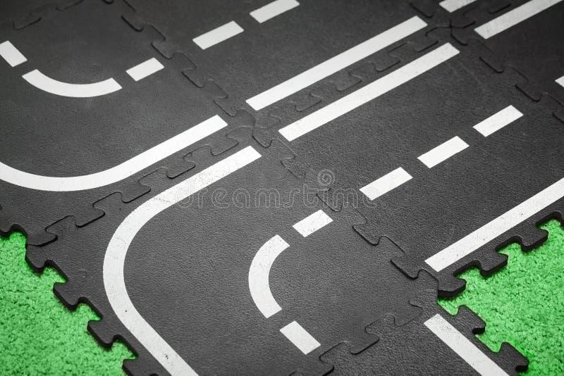 Extrahieren Sie Straßenhintergrund - Spielplatzteppich lizenzfreie stockfotografie