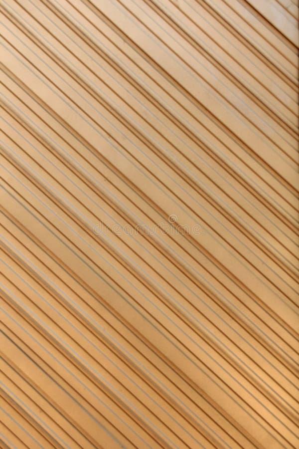 Extrait géométrique en métal dans la couleur d'or images stock