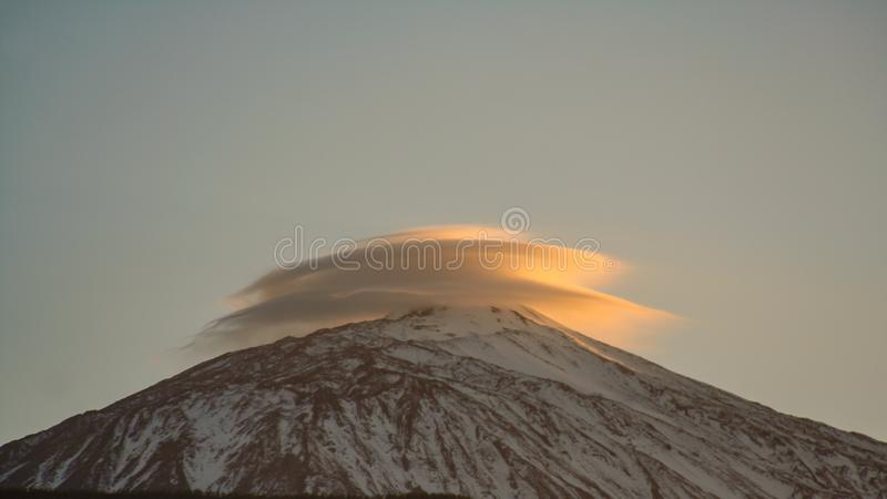 Extraordinary cloud formation over the mountain. A extraordinary cloud formation over the mountain royalty free stock image
