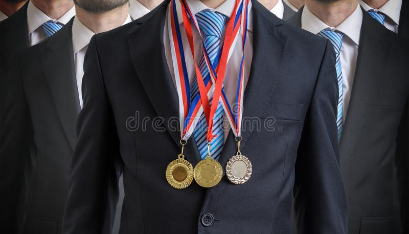 Extraordinary successful employee was awarded for his excellent skills.  royalty free stock photo