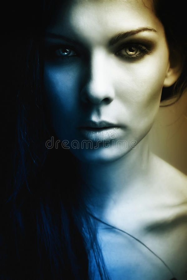 Extravagant beautiful girl dark portrait. Extravagant beautiful girl dark mystery portrait royalty free stock photography