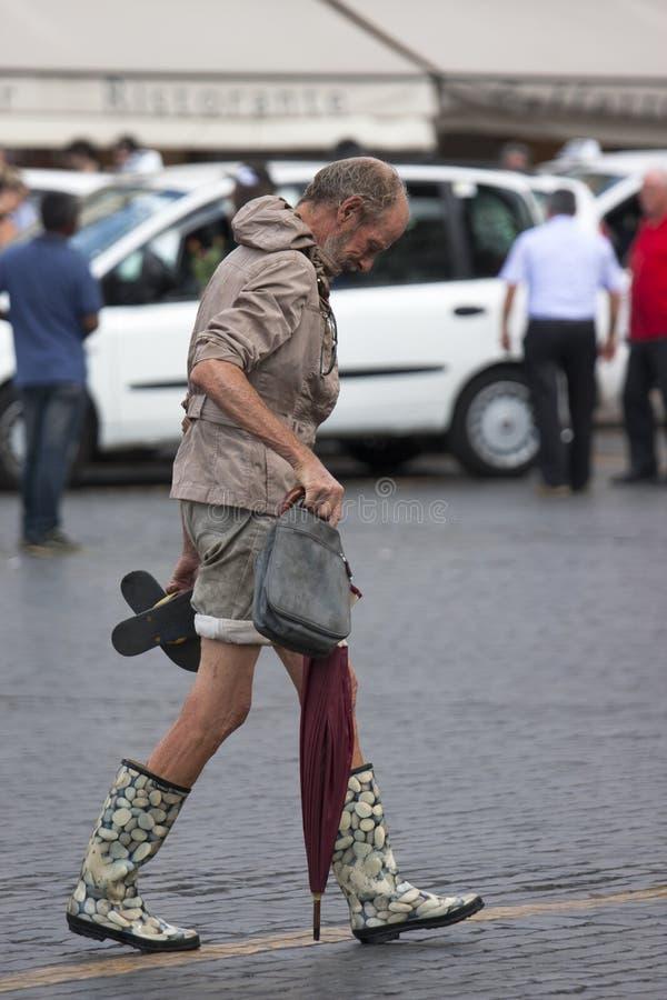 Extravagant clothes man walking royalty free stock images