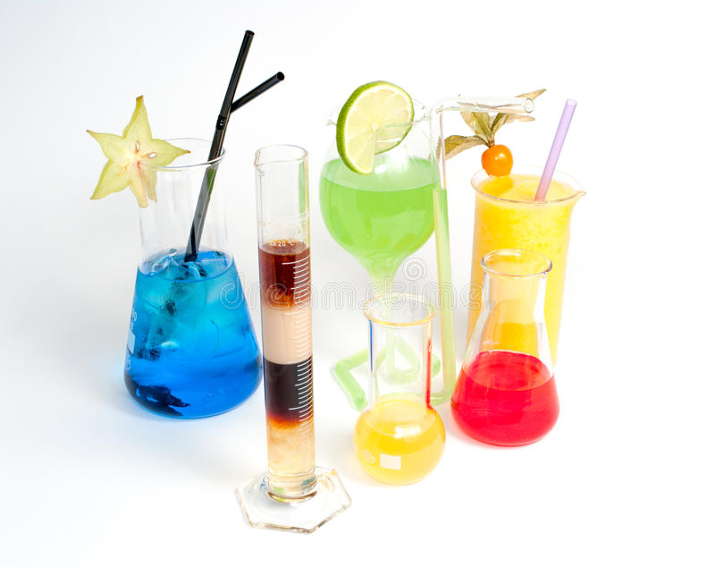 Extravagant, colorful beverages in fancy glasses stock photography